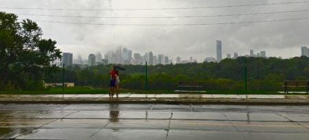 A couple in the rain enjoys the city views